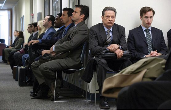 A dozen job applicants waiting for interviews