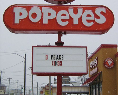 Fast food sign with piece spelled as peace