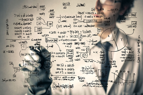 Scientist writing calculations on a board